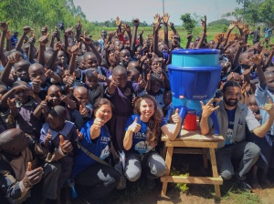 Part of our team, with a Lifestraw community filter.