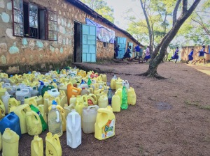 Water jugs at the ready, waiting for the kids to fetch water from the river.